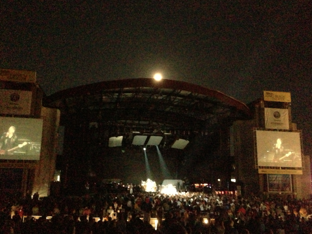 moon climbing over bandshell